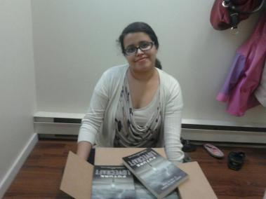 "Author photo of Silvia Moreno-Garcia with the collection ""Future Lovecraft"""
