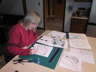 Photo of Julie Czerneda map-building by Roger Czerneda.