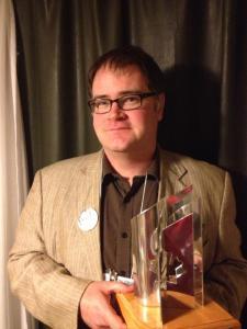 Derek Newman-Stille with the Prix Aurora Award, October 6, 2013. Photo credit Dwayne Collins.